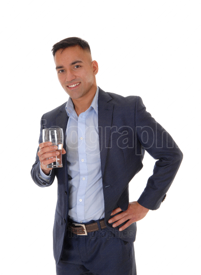 Thirsty man drinking a glass on water