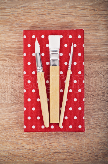 Three paintbrushes ready to create art