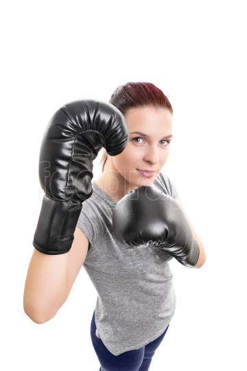 Top down view of a beautiful young woman with boxing gloves