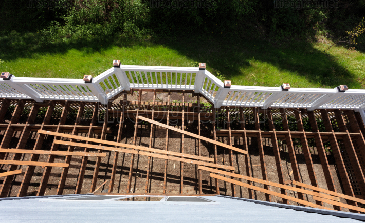 Top view of an aged outdoor wooden cedar deck being tore down du