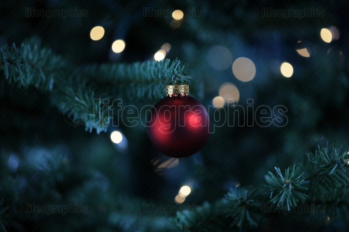 Traditional artificial Christmas tree with red ball ornament and