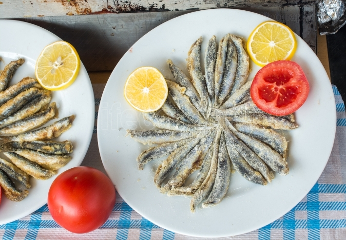 Tray with ready to fry anchovies fish