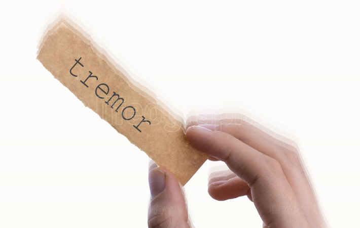 Tremor word on torn notepaper in hand