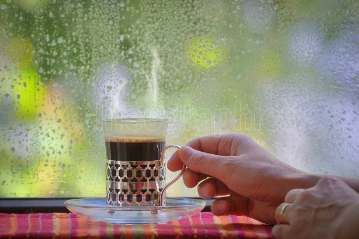 Turkish Coffee cup at rainy window