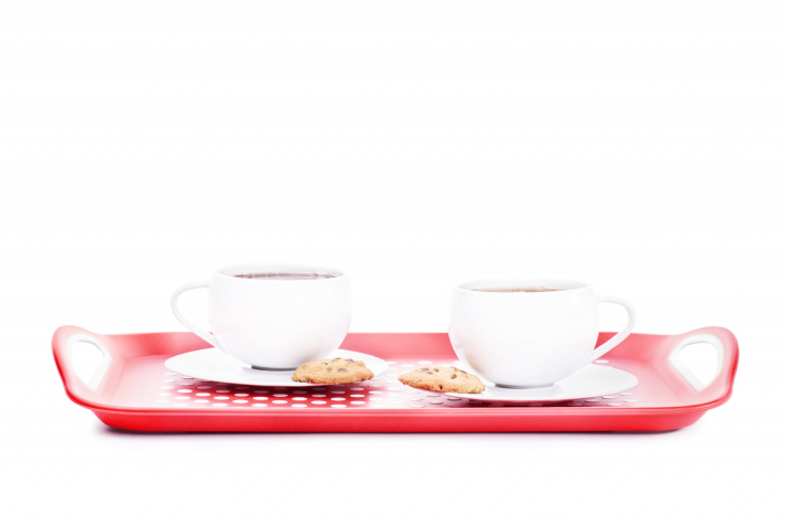 Two cups of tea with cookies on a platter