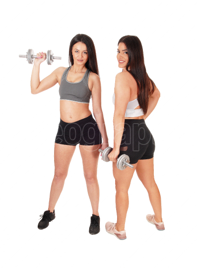 Two women in the studio with dumbbells working out