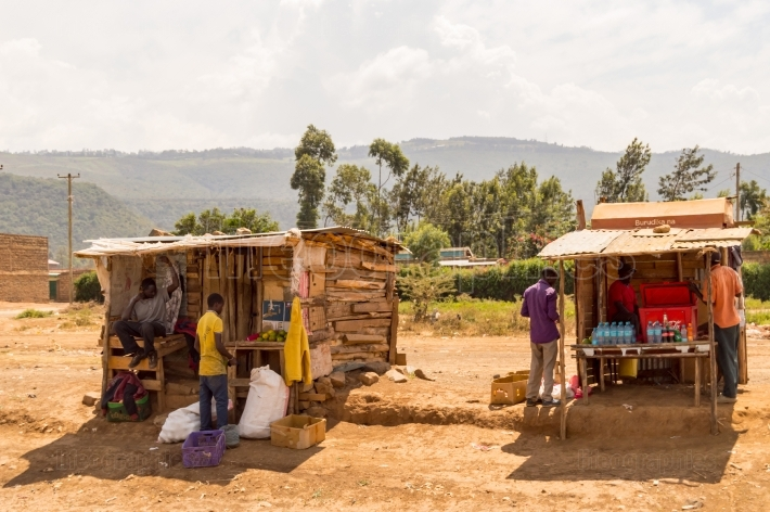 Two wooden stalls on the roadside in Kenya s rift valley