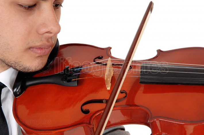 Very close up of young man playing the violin