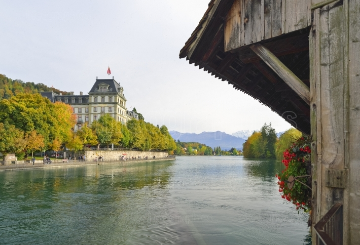 View of the city and alps from sluice bridge in thun, switzerland. aare river.