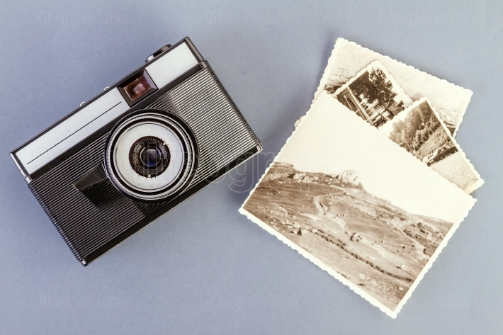 Vintage photo camera and old photos