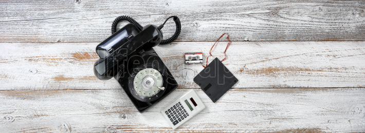 Vintage technology includes rotary dial phone and old data disk