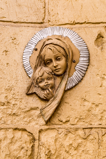 Virgin Mary icon  Religious icon on stone wall