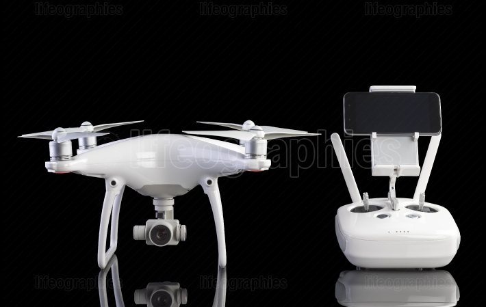 White drone against black background.