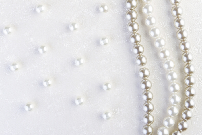 White pearls necklace on white paper