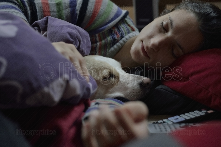 Woman and dog and bed