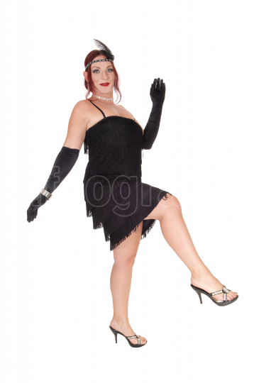 Woman dancing in a black dress