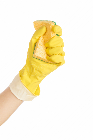 Woman hand holding a cleaning sponge isolated on white