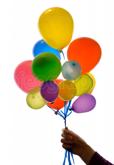 Woman hand holding balloons