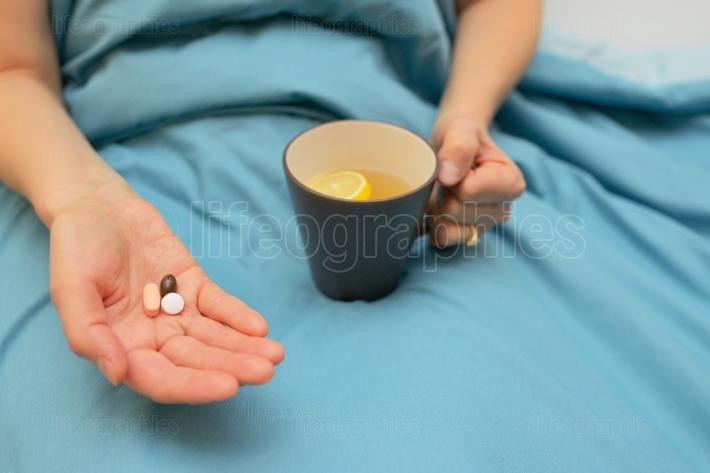Woman hands taking medicines