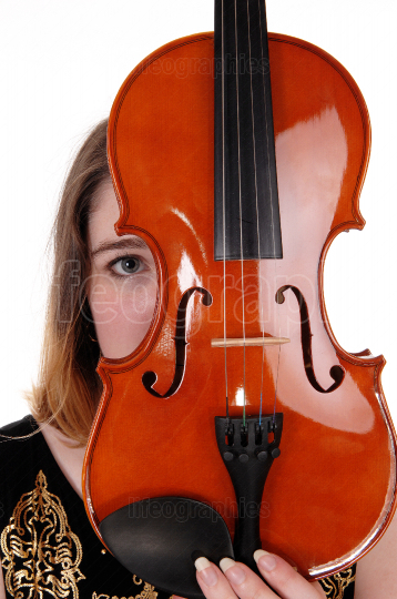 Woman hiding behind a violin