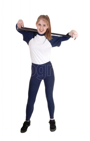 Woman holding her softball bat over her shoulder