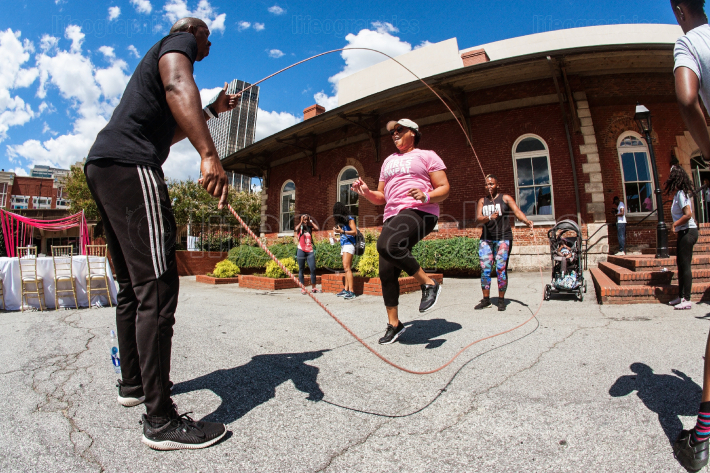 Woman Jumps Rope Double Dutch Style At Atlanta Fitness Festival