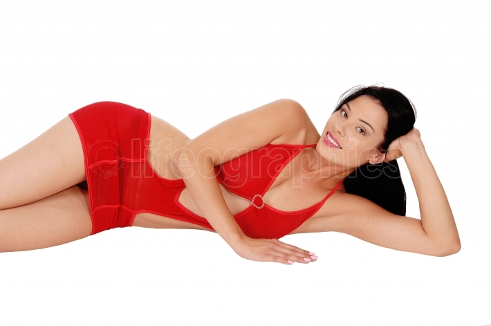 Woman lying in red lingerie on the floor
