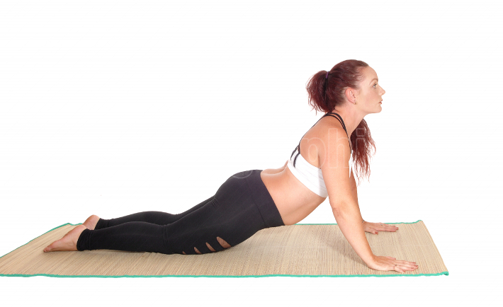 Woman lying on the floor doing push ups