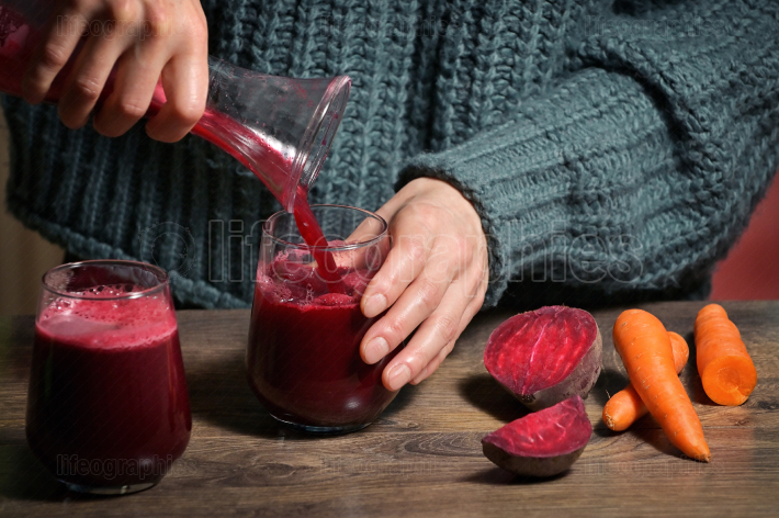 Woman Pouring Self Made Beet Juice