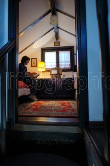 Woman reading Bible inside of room