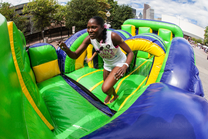 Woman Runs Through Inflatable Obstacle Course At Atlanta Fitness Event