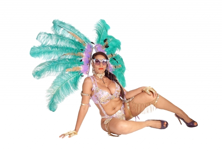 Woman sitting in carnival outfit on floor