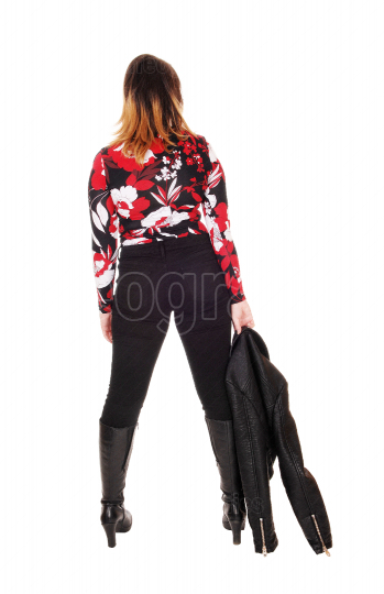 Woman standing from back in boots