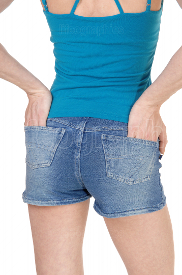 Woman standing from back in jeans shorts, close up