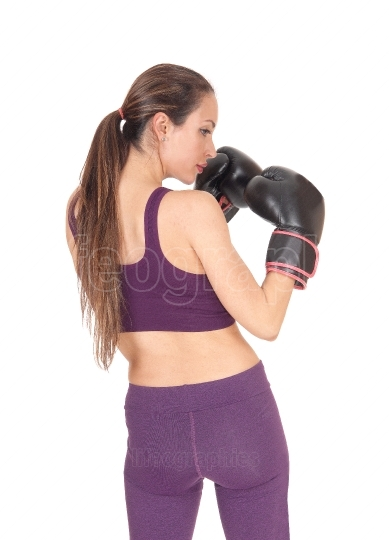 Woman standing from back with boxing cloves