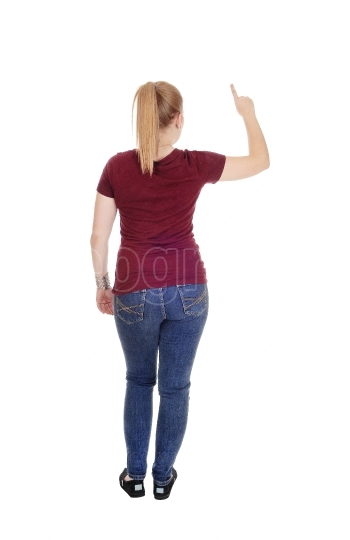 Woman standing from back with finger up