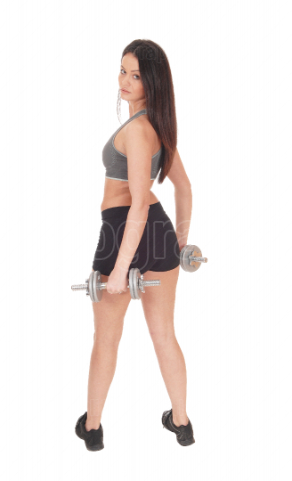 Woman standing from back with two dumbbells