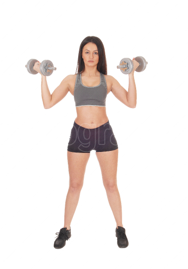 Woman standing from the front with two dumbbells