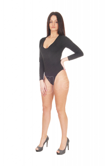 Woman standing in a black body suit from the front