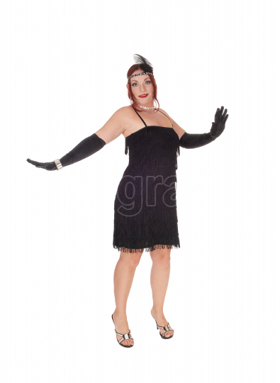 Woman standing in a black dress and long cloves
