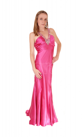 Woman standing in an pink long evening gown