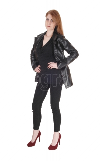 Woman standing in leather jacket