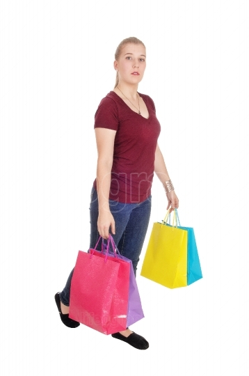 Woman walking with colorful shopping bags