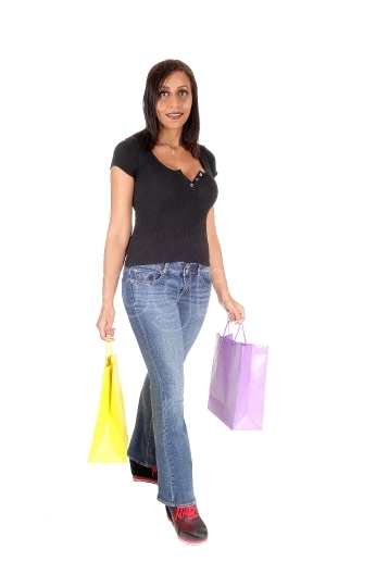 Woman walking with her shopping bags