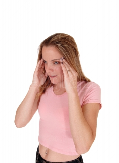 Woman with a headache holding her hand on head