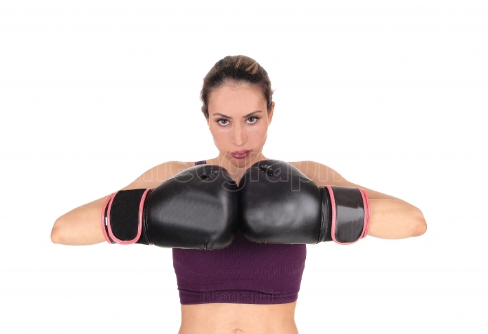 Woman with boxing gloves looking, smiling