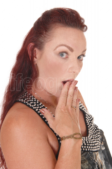 Woman with her finger over her mouth