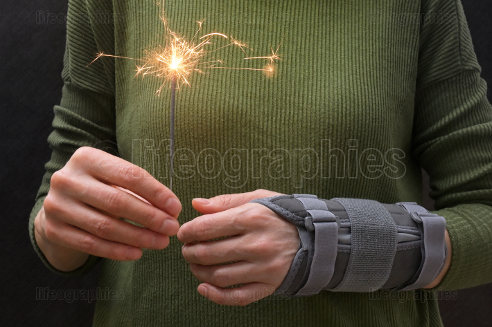 Woman With Sparkler and Contused Hand