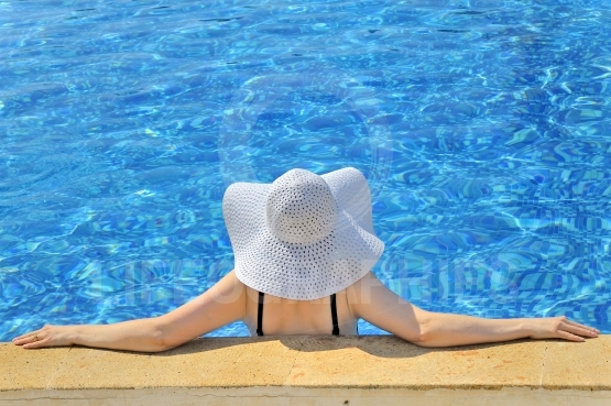 Woman with white hat relaxing