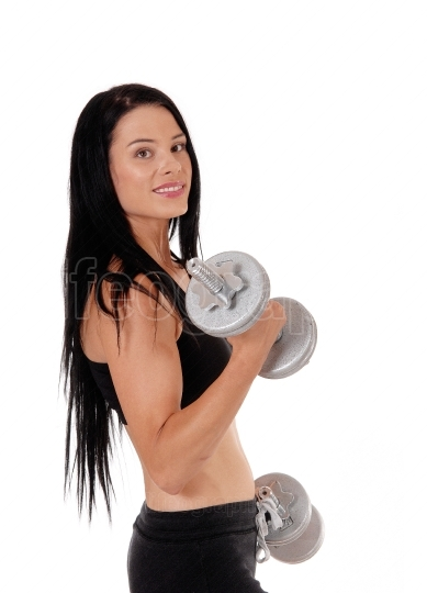 Woman workout whit two dumbbells smiling